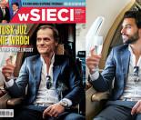 Tusk pije szampana w samolocie na okładce