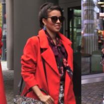 Macademian Girl w czerwonym płaszczu pod TVN-em