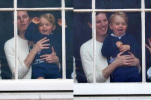 Książę Jerzy z nianią w oknie pałacu Buckingham (ZDJĘCIA)