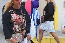 Beyonce zasłania brzuch torebką!