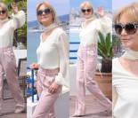 Zadowolona Grażyna Torbicka macha Kurskiemu z tarasu w Cannes (ZDJĘCIA)