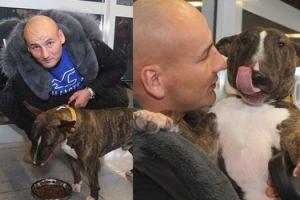 Artur Szpilka pozuje z psem na lotnisku (ZDJĘCIA)